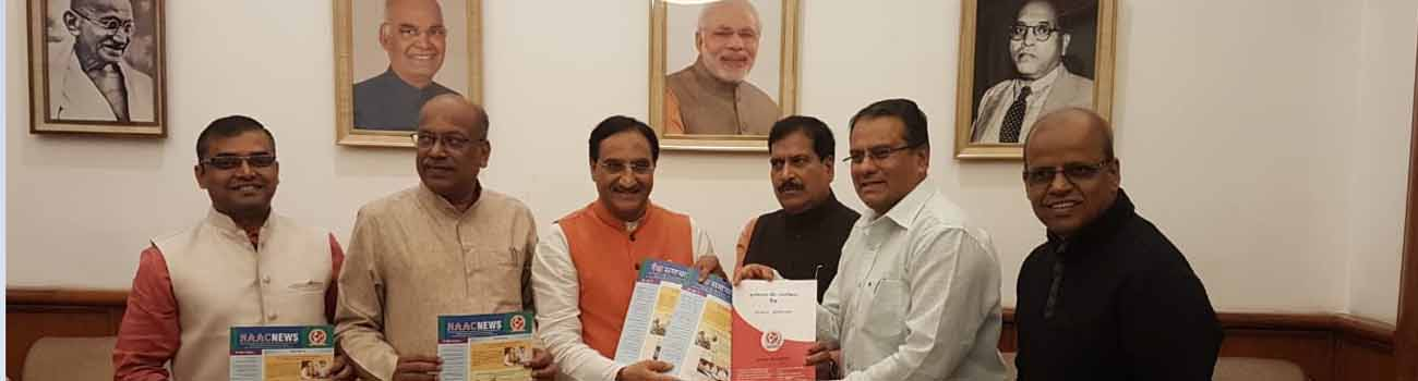 Photo of release of NAAC newsletter by Dr Ramesh Pokhriyal Nishank, Hon'ble Minister of Education, Government of India